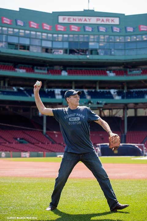 """""""Singer James Taylor warms up in preparation to throw out the ceremonial first pitch before a game at Fenway Park in Boston, Massachusetts Sunday, May 3, 2015."""""""