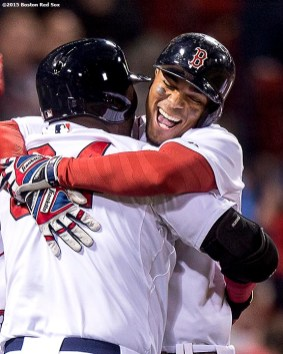 """""""Boston Red Sox shortstop Xander Bogaerts hugs designated hitter David Ortiz after hitting a go ahead grand slam during the eighth inning of a game against the Tampa Bay Rays at Fenway Park in Boston, Massachusetts Monday, September 21, 2015."""""""