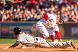 """""""Boston Red Sox second baseman Brock Holt applies a tag on third baseman Manny Machado as he steals during the sixth inning of a game against the Baltimore Orioles at Fenway Park in Boston, Massachusetts Sunday, September 27, 2015."""""""