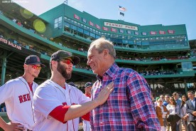 """""""Boston Red Sox President & CEO Larry Lucchino is congratulated by second baseman Dustin Pedroia during a tribute ceremony for Larry Lucchino before a game between the Boston Red Sox and the Baltimore Orioles at Fenway Park in Boston, Massachusetts Sunday, September 27, 2015."""""""
