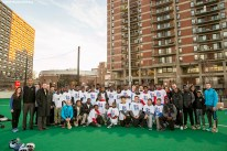 """""""Guests pose for a group photo during a hurling clinic at New Balance Field at Boston University in Boston, Massachusetts ahead of the AIG Fenway Hurling Classic and Irish Festival Tuesday, November 17, 2015."""""""