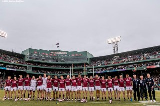 """""""The Galway team looks on as the National Anthem is played during the AIG Hurling Classic and Irish Festival game against Dublin at Fenway Park in Boston, Massachusetts Saturday, November 22, 2015."""""""