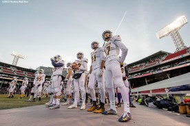 """""""Members of the Xaverian Brothers High School football team look on before a game against St. John's Preparatory School at Fenway Park in Boston, Massachusetts Wednesday, November 25, 2015."""""""