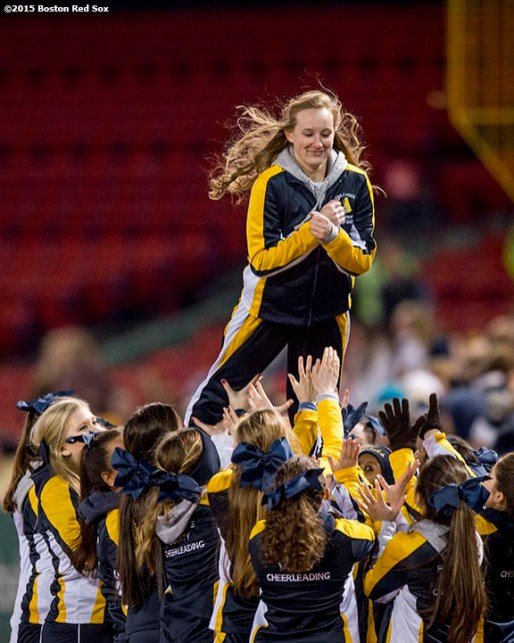 """""""A cheerleader is lifted in the air during a high school football game between Xaverian Brothers High School and St. John's Preparatory School at Fenway Park in Boston, Massachusetts Wednesday, November 25, 2015."""""""