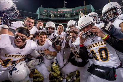 """""""Members of the Xaverian Brothers High School football team react after defeating St. John's Preparatory School at Fenway Park in Boston, Massachusetts Wednesday, November 25, 2015."""""""