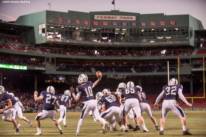 """""""Game action during a high school football game between Xaverian Brothers High School and St. John's Preparatory School at Fenway Park in Boston, Massachusetts Wednesday, November 25, 2015."""""""