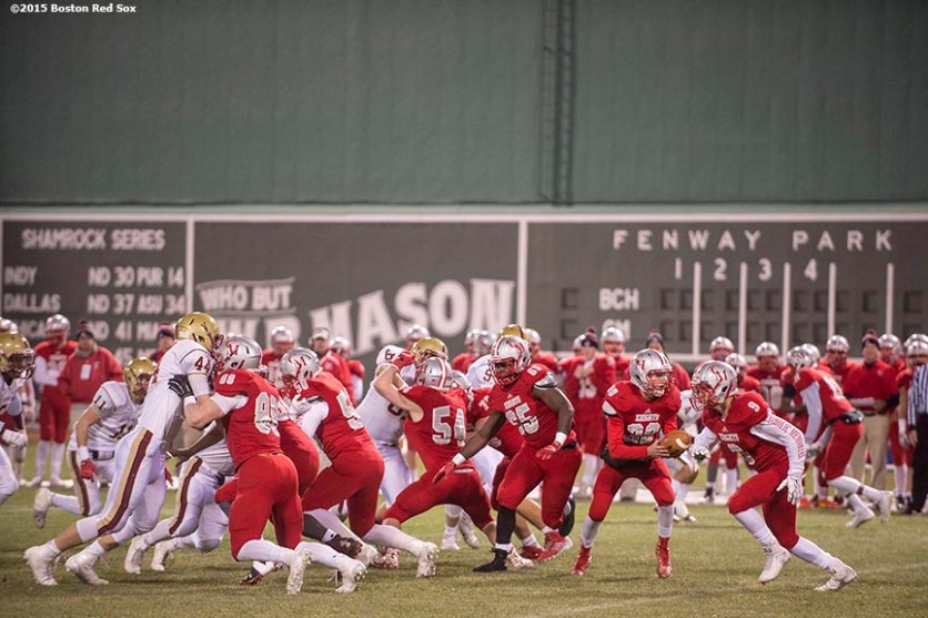 """""""Game action during a high school football game between Boston College High School and Catholic Memorial High School at Fenway Park in Boston, Massachusetts Wednesday, November 25, 2015."""""""