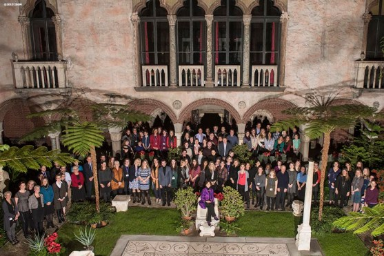 """""""Museum Director Anne Hawley poses with staff for a group photo in the courtyard during a staff party at the Isabella Stewart Gardner Museum in Boston, Massachusetts Wednesday, December 2, 2015."""""""