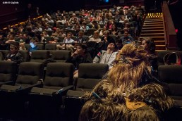 """""""Chewbacca sits in a theatre with guests during an advanced screening of 'Star Wars: The Force Awakens' for Goldman Sachs at Loews Theatre in Boston, Massachusetts Thursday, December 17, 2015."""""""