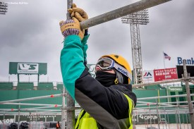 """""""A worker installs beams as progress begins on construction of the Big Air ski and snowboard ramp at Fenway Park in Boston, Massachusetts Tuesday, January 19, 2016."""""""
