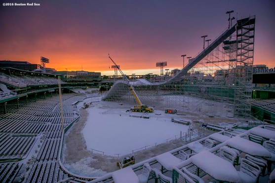 """""""The sun sets as construction continues on the Polartec Big Air ski and snowboard ramp at Fenway Park in Boston, Massachusetts Friday, February 5, 2016."""""""