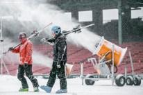 """Volunteers prepare snow on the Polartec Big Air ski and snowboard ramp at Fenway Park in Boston, Massachusetts Monday, February 8, 2016."""