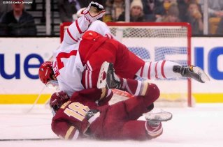 BOSTON, MA - FEBRUARY 08: Charlie McAvoy #7 of Boston University trips over Colin White #18 during the first period of the Beanpot Tournament championship game at TD Garden on February 8, 2016 in Boston, Massachusetts. (Photo by Billie Weiss/Getty Images) *** Local Caption *** Charle McAvoy;Colin White