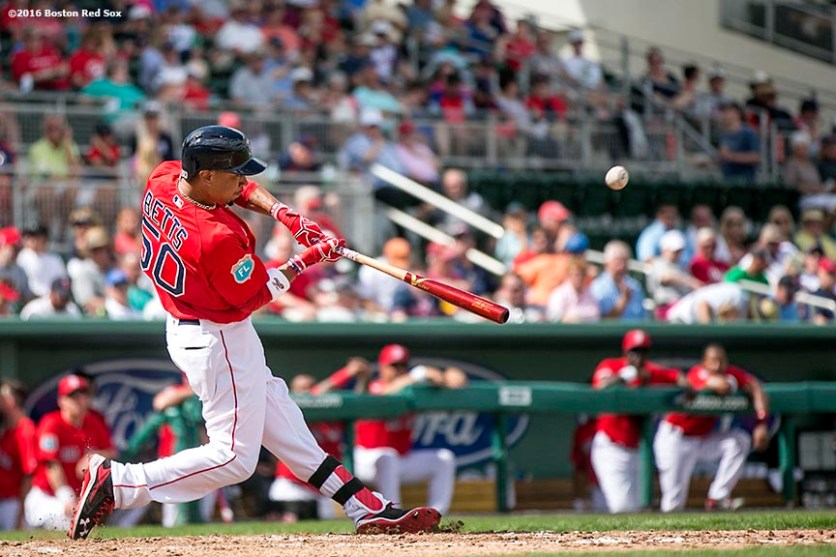 February 29, 2016, Fort Myers, FL: Center fielder Mookie Betts hits a three run home run during an exhibition game between the Boston Red Sox and Boston College at JetBlue Park in Fort Myers, Florida Monday, February 29, 2016. (Photos by Billie Weiss/Boston Red Sox)