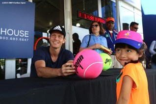 """""""Tomas Berdych signs autographs at the Tennis Warehouse booth during the 2016 BNP Paribas Open at the Indian Wells Tennis Garden in Indian Wells, California Sunday, March 13, 2016."""""""