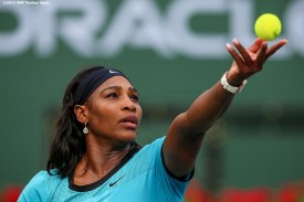 """""""Serena Williams serves against Yulia Putintseva during the 2016 BNP Paribas Open at the Indian Wells Tennis Garden in Indian Wells, California Sunday, March 13, 2016."""""""
