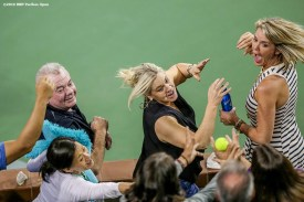 """""""Fans reach for a stray tennis ball during the 2016 BNP Paribas Open at the Indian Wells Tennis Garden in Indian Wells, California Tuesday, March 15, 2016."""""""