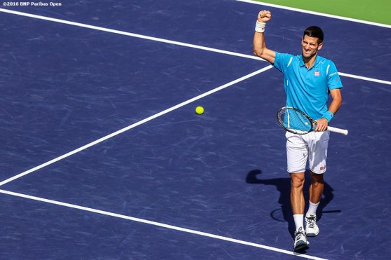 """""""Novak Djokovic reacts after defeating Milos Raonic in the men's finals during the 2016 BNP Paribas Open at the Indian Wells Tennis Garden in Indian Wells, California Sunday, March 20, 2016."""""""