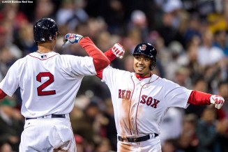 BOSTON, MA - APRIL 20: Mookie Betts #50 reacts with Xander Bogaerts #2 of the Boston Red Sox after hitting a two run home run during the second inning of a game against the Tampa Bay Rays on April 20, 2016 at Fenway Park in Boston, Massachusetts . (Photo by Billie Weiss/Boston Red Sox/Getty Images) *** Local Caption *** Mookie Betts; Xander Bogaerts