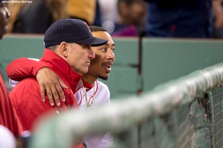 BOSTON, MA - APRIL 20: Mookie Betts #50 of the Boston Red Sox talks with bench coach Torey Lovullo during the fifth inning of a game against the Tampa Bay Rays on April 20, 2016 at Fenway Park in Boston, Massachusetts . (Photo by Billie Weiss/Boston Red Sox/Getty Images) *** Local Caption *** Mookie Betts; Torey Lovullo