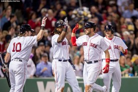 BOSTON, MA - MAY 10: Travis Shaw #47 of the Boston Red Sox high fives Josh Rutledge #32, Hanley Ramirez #13, and Ryan Hanigan #10 after hitting a three run home run during the fifth inning of a game against the Oakland Athletics on May 10, 2016 at Fenway Park in Boston, Massachusetts. (Photo by Billie Weiss/Boston Red Sox/Getty Images) *** Local Caption *** Travis Shaw; Josh Rutledge; Ryan Hanigan; Hanley Ramirez