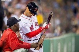 BOSTON, MA - MAY 10: Mookie Betts #50 of the Boston Red Sox reviews notes with hitting coach Chili Davis #44 during the fifth inning of a game against the Oakland Athletics on May 10, 2016 at Fenway Park in Boston, Massachusetts. (Photo by Billie Weiss/Boston Red Sox/Getty Images) *** Local Caption *** Chili Davis; Mookie Betts