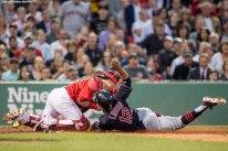 BOSTON, MA - MAY 20: Francisco Lindor #12 of the Cleveland Indians avoids the tag of Christian Vazquez #7 of the Boston Red Sox as he scores during the third inning of a game on May 20, 2016 at Fenway Park in Boston, Massachusetts. (Photo by Billie Weiss/Boston Red Sox/Getty Images) *** Local Caption *** Francisco Lindor; Christian Vazquez