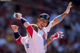 BOSTON, MA - JUNE 19: Mookie Betts #50 of the Boston Red Sox reacts with Christian Vazquez #7 after hitting a go ahead solo home run during the eighth inning of a game against the Seattle Mariners on June19, 2016 at Fenway Park in Boston, Massachusetts. (Photo by Billie Weiss/Boston Red Sox/Getty Images) *** Local Caption *** Mookie Betts; Christian Vazquez