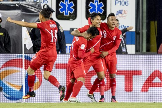FOXBORO, MASSACHUSETTS - JUNE 12: Raúl Ruidíaz of Peru reacts with teammates after scoring a goal during a group B match between Brazil and Peru at Gillette Stadium as part of Copa America Centenario US 2016 on June 12, 2016 in Foxboro, Massachusetts, US. (Photo by Billie Weiss/LatinContent/Getty Images)