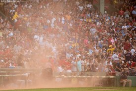 BOSTON, MA - JULY 23: Members of the Minnesota Twins react as wind blows dust on the field during the first inning of a game against the Boston Red Sox on July 23, 2016 at Fenway Park in Boston, Massachusetts. (Photo by Billie Weiss/Boston Red Sox/Getty Images) *** Local Caption ***