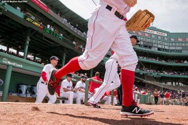 BOSTON, MA - JULY 24: Members of the Boston Red Sox run onto the field before a game against the Minnesota Twins on July 24, 2016 at Fenway Park in Boston, Massachusetts. (Photo by Billie Weiss/Boston Red Sox/Getty Images) *** Local Caption ***