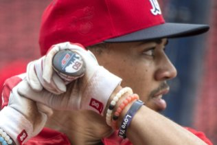 BOSTON, MA - JULY 25: Mookie Betts #50 of the Boston Red Sox takes batting practice before a game against the Detroit Tigers on July 25, 2016 at Fenway Park in Boston, Massachusetts. (Photo by Billie Weiss/Boston Red Sox/Getty Images) *** Local Caption *** Mookie Betts
