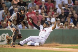 BOSTON, MA - JULY 25: Jackie Bradley Jr. #25 of the Boston Red Sox slides as he scores during the second inning of a game against the Detroit Tigers on July 25, 2016 at Fenway Park in Boston, Massachusetts. (Photo by Billie Weiss/Boston Red Sox/Getty Images) *** Local Caption *** Jackie Bradley Jr.