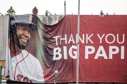 BOSTON, MA - AUGUST 12: A new billboard for David Ortiz #34 of the Boston Red Sox is installed on Lansdowne Street above Fenway Park before a game between the Boston Red Sox and the Arizona Diamondbacks on August 12, 2016 at Fenway Park in Boston, Massachusetts. It was his second three run home run of the game. (Photo by Billie Weiss/Boston Red Sox/Getty Images) *** Local Caption *** David Ortiz