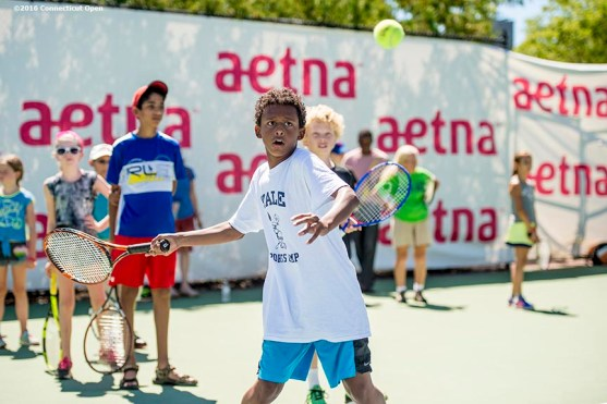 August 22, 2016, New Haven, Connecticut: A fan participates in the Free Tennis Lesson in the Aetna Fit Zone during Day 4 of the 2016 Connecticut Open at the Yale University Tennis Center on Monday August 22, 2016 in New Haven, Connecticut. (Photo by Billie Weiss/Connecticut Open)