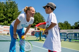 August 23, 2016, New Haven, Connecticut: Svetlana Kuznetsova of Russia plays tennis with a kid during a Latino Day clinic at the AETNA Fit Zone during Day 5 of the 2016 Connecticut Open at the Yale University Tennis Center on Tuesday, August 23, 2016 in New Haven, Connecticut. (Photo by Billie Weiss/Connecticut Open)