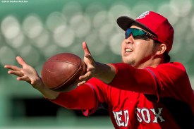 BOSTON, MA - SEPTEMBER 12: Junichi Tazawa #36 of the Boston Red Sox catches a football before a game against the Baltimore Orioles on September 12, 2016 at Fenway Park in Boston, Massachusetts. (Photo by Billie Weiss/Boston Red Sox/Getty Images) *** Local Caption *** Junichi Tazawa