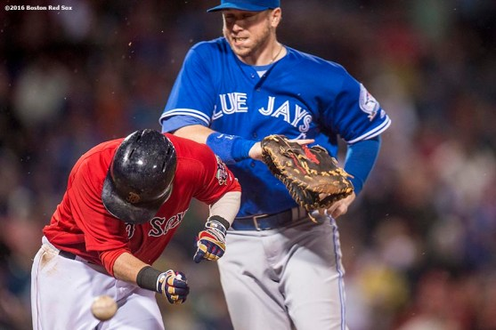 BOSTON, MA - SEPTEMBER 30: Dustin Pedroia #15 of the Boston Red Sox beats out a throw as Justin Smoak #14 of the Toronto Blue Jays reaches for the ball during the seventh inning of a game on September 30, 2016 at Fenway Park in Boston, Massachusetts. (Photo by Billie Weiss/Boston Red Sox/Getty Images) *** Local Caption *** Dustin Pedroia; Justin Smoak