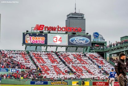 BOSTON, MA - OCTOBER 2: Fans hold up cards to form a 'Thanks Papi' message in the outfield bleachers as David Ortiz #34 of the Boston Red Sox bats during the second inning of his final regular season game at Fenway Park against the Toronto Blue Jays on October 2, 2016 at Fenway Park in Boston, Massachusetts. (Photo by Billie Weiss/Boston Red Sox/Getty Images) *** Local Caption *** David Ortiz
