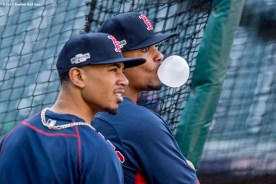 CLEVELAND, OH - OCTOBER 5: Xander Bogaerts #2 and Mookie Betts #50 of the Boston Red Sox look on during a team workout before game one of the American League Division Series against the Cleveland Indians on October 5, 2016 at Progressive Field in Cleveland, Ohio. (Photo by Billie Weiss/Boston Red Sox/Getty Images) *** Local Caption *** Mookie Betts; Xander Bogaerts