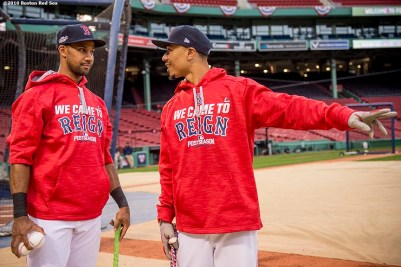 BOSTON, MA - OCTOBER 8: Chris Young #30 and Mookie Betts #50 of the Boston Red Sox talk during a workout before game three of the American League Division Series against the Cleveland Indians on October 8, 2016 at Fenway Park in Boston, Massachusetts. (Photo by Billie Weiss/Boston Red Sox/Getty Images) *** Local Caption *** Chris Young; Mookie Betts