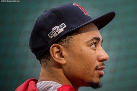 BOSTON, MA - OCTOBER 8: Mookie Betts #50 of the Boston Red Sox looks on during a workout before game three of the American League Division Series against the Cleveland Indians on October 8, 2016 at Fenway Park in Boston, Massachusetts. (Photo by Billie Weiss/Boston Red Sox/Getty Images) *** Local Caption *** Mookie Betts