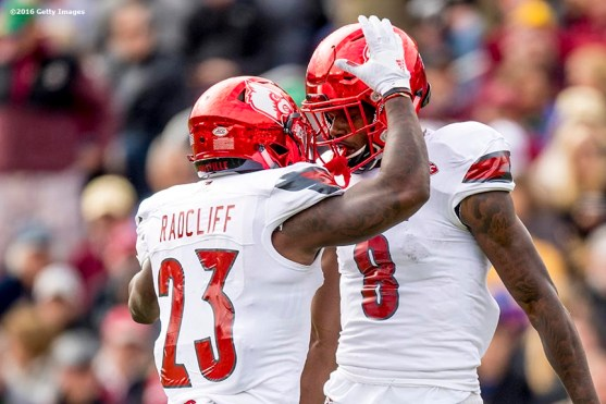 CHESTNUT HILL, MA - NOVEMBER 05: Lamar Jackson #8 of Louisville reacts with Brandon Radcliff #23 after throwing a touchdown pass during the second quarter of a game against Boston College at Alumni Stadium on November 5, 2016 in Chestnut Hill, Massachusetts. (Photo by Billie Weiss/Getty Images) *** Local Caption *** Lamar Jackson; Brandon Radcliff