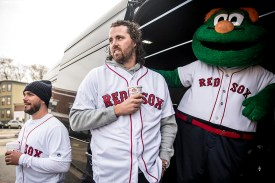 """""""Boston Red Sox pitchers Robby Scott and Heath Hembree and mascot Wally the Green Monster wait with the van before making an appearance at Codman Academy School as part of The Gift Of Sox and the Holiday Caravan in Dorchester, Massachusetts Thursday, December 8, 2016."""""""