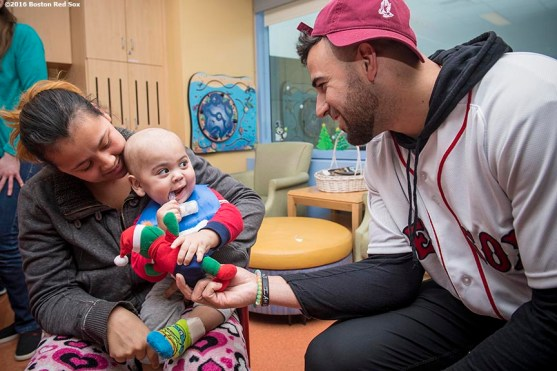 """""""Boston Red Sox infielder Deven Marrero greets a patient during a visit to Massachusetts General Hospital as part of the 2016 Holiday Caravan in Boston, Massachusetts Thursday, December 8, 2016."""""""