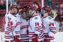 BOSTON, MA - JANUARY 08: Members of the University of Massachusetts react after scoring a goal during a Frozen Fenway game against Boston University at Fenway Park on January 8, 2017 in Boston, Massachusetts. (Photo by Billie Weiss/Boston Red Sox/Getty Images)