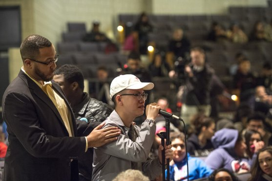 January 27, 2017, Boston, MA: Jae Holland of the Boston Red Sox consoles a student as he cries while asking a question during a Jackie Robinson Day recognition event at Charlestown High School in Boston, Massachusetts Friday, January 27, 2017. (Photo by Billie Weiss/Boston Red Sox)