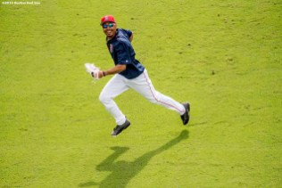 FT. MYERS, FL - MARCH 2: Mookie Betts #50 of the Boston Red Sox reacts as he tracks down a fly ball during warm ups before a Spring Training game against the Tampa Bay Rays on March 2, 2017 at Fenway South in Fort Myers, Florida . (Photo by Billie Weiss/Boston Red Sox/Getty Images) *** Local Caption *** Mookie Betts