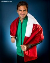 Roger Federer wears a Swiss flag as he poses for a portrait after winning the men's singles final against Stan Wawrinka at the Indian Wells Tennis Garden in Indian Wells, California on Sunday, March 19, 2017. (Photo by Billie Weiss/BNP Paribas Open)