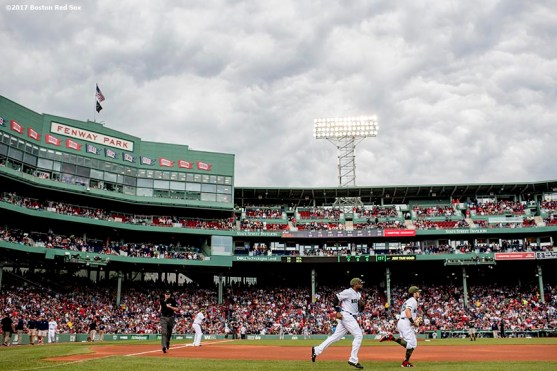 BOSTON, MA - MAY 28: Jackie Bradley Jr. #19 and Andrew Benintendi #16 of the Boston Red Sox run onto the field before a game against the Seattle Mariners on May 28, 2017 at Fenway Park in Boston, Massachusetts. (Photo by Billie Weiss/Boston Red Sox/Getty Images) *** Local Caption *** Jackie Bradley Jr.; Andrew Benintendi